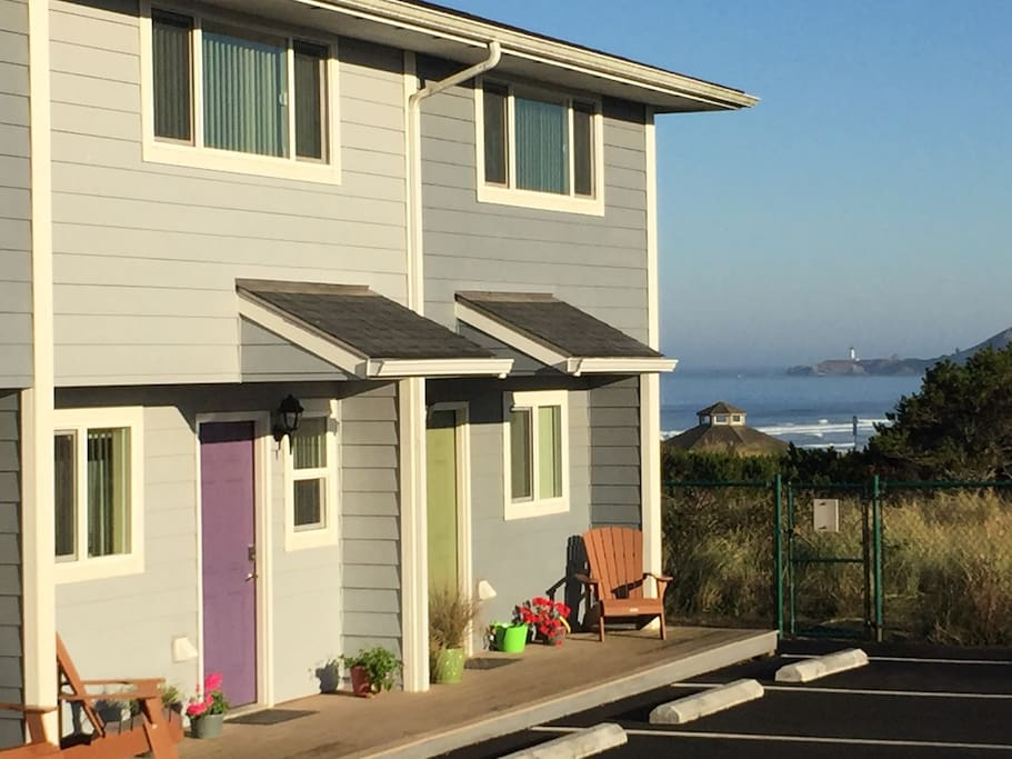 Nye Beach Townhomes with Don Davis Park Beach access and Yaquina Lighthouse in the background just 1 block away!