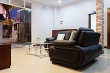 Vung Tau Villa Ali 5B has a modern spacious living room in ground floor with TV, sofa,..