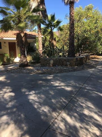 Gated long driveway to 2 private parking spaces with a paved path to  the cottage front door.  Front porch has a motion sensor light for convenience, serenity & security.  Sit on the porch bench & watch numerous hummingbirds at the feeder.