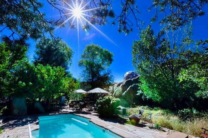 This lovely pool is perfect for swims, floats & potlucks in the pool. It's surrounded by multiple flagstone patios & paths. Do you see the Dome perched up on the cliff? Adjacent to the Dome, the Cave Castle is hidden behind the trees to its left.