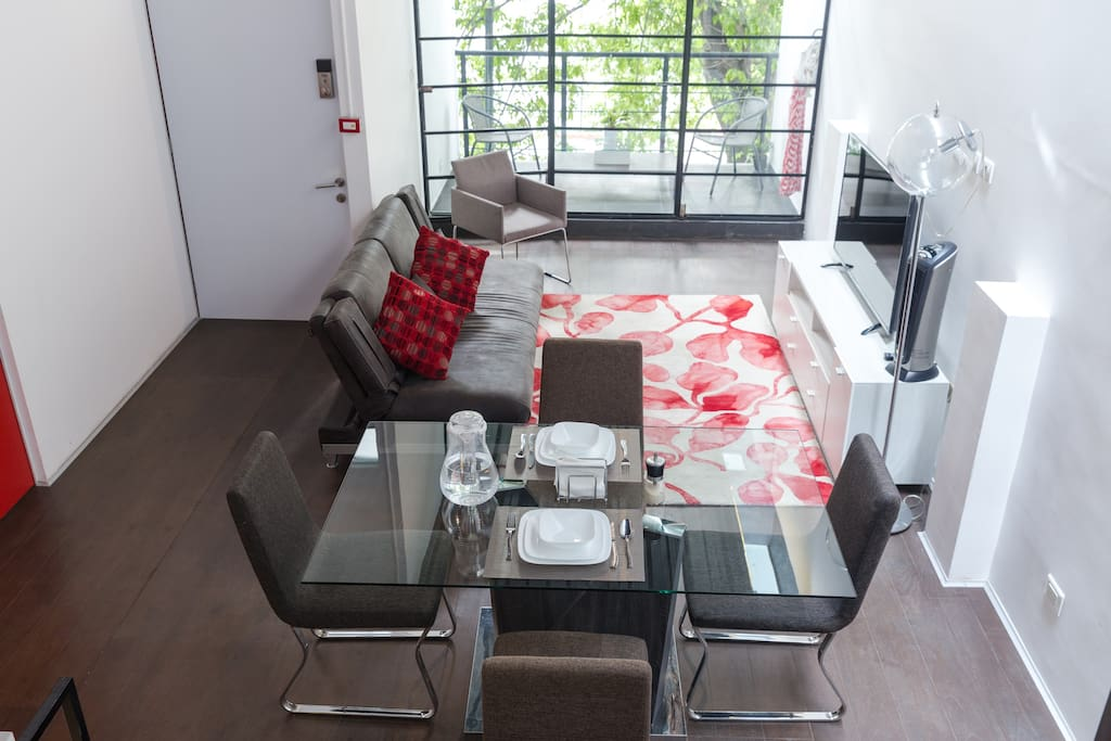 Double height.  This image was taken from the bedroom looking down at the table, sofa and balcony.