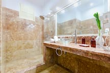 Our spacious bathroom made with Cuban Red marble, like an ice cream to the eyes