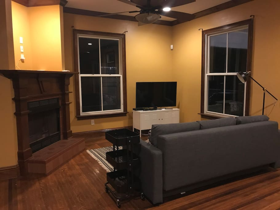 """Living room with 55"""" Smart TV - basic cable HBO, Netflix, and Amazon Prime Video"""