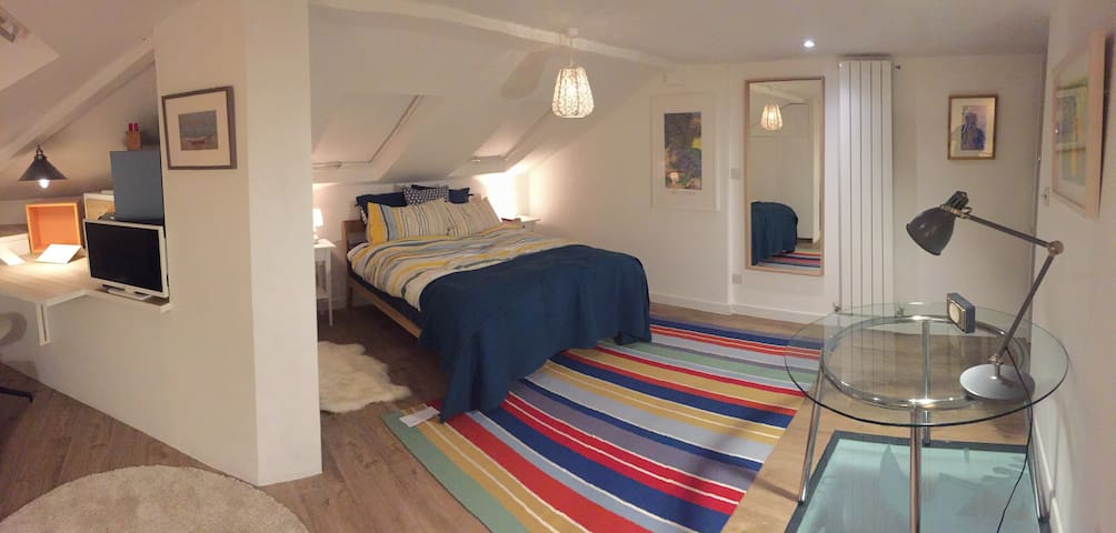 At night with bedside lamps and sheepskin rugs either side. Large mirror. Stylish radiator keeps this well insulated accomodation a comfortable temperature. Blackout blinds or if you prefer fall sleep estching the stars and constrllations then wake to natural daylight!