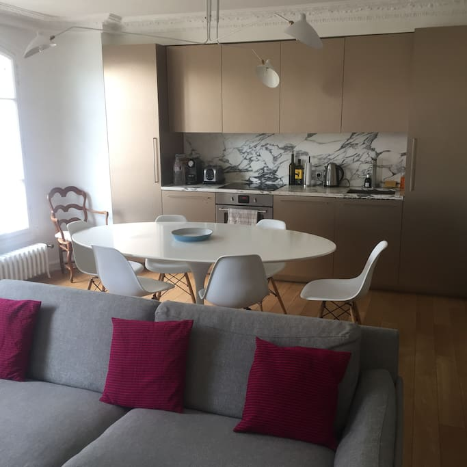 Eating and cooking area. Open to living area. With nespresso, electric kettle, stove, oven, dishwasher, freezer, and fridge.