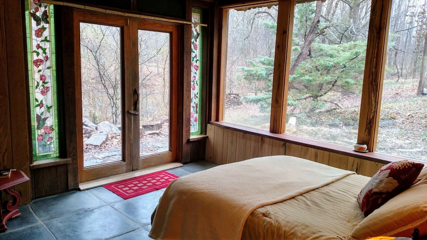 You have a beautiful view of the stars and moon, forest and pond, and wildlife right from your bed or in the next room. The bed and pond room have floor to ceiling windows facing the pond and forest. One with nature.