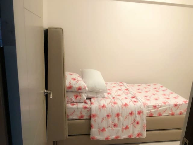Bedroom 2 , single bed with pull out bed. With cold AC. Spacious and always fresh and clean.