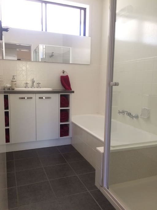 Partly renovated bathroom.  Gorgeous vanity unit. includes shower,and bath