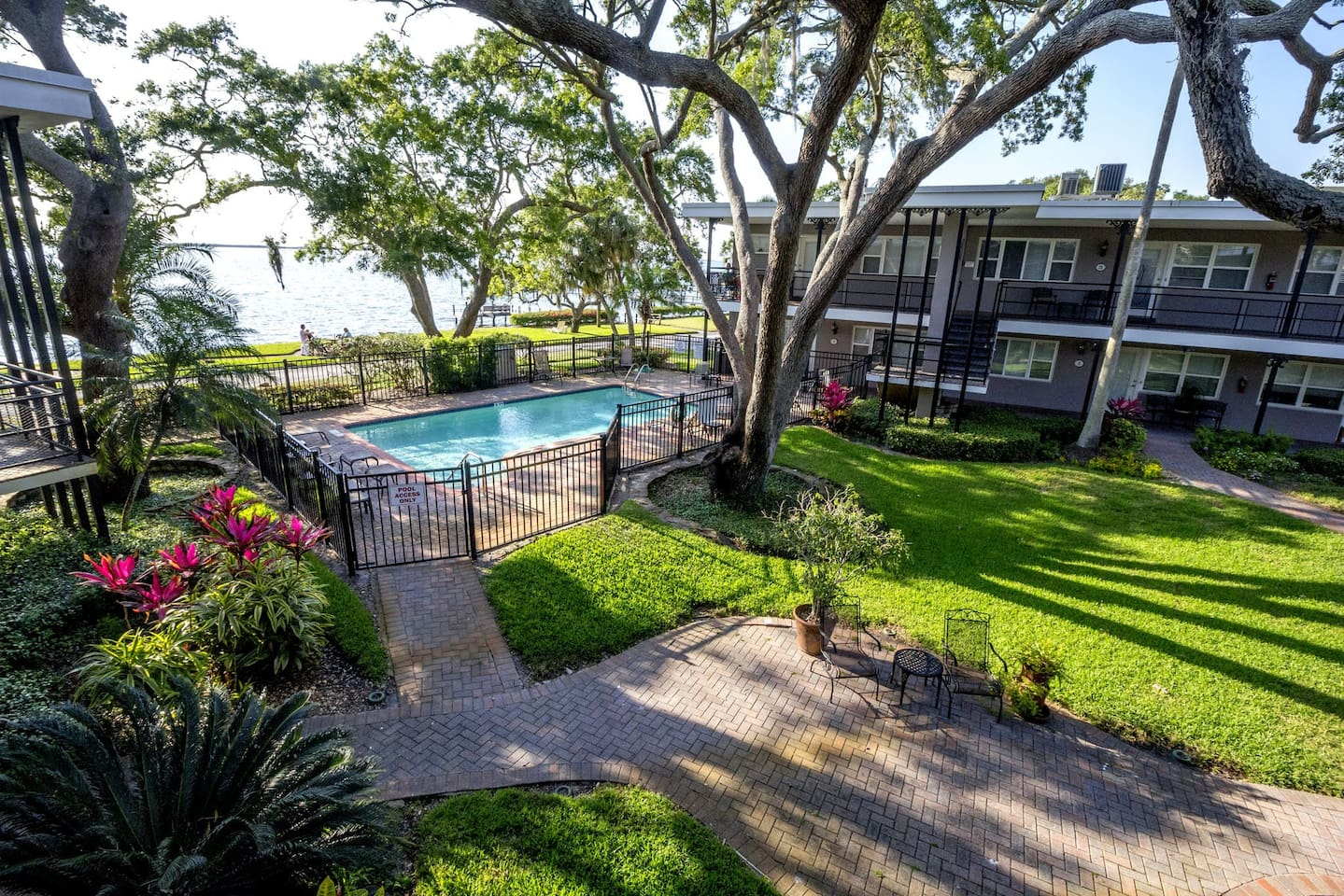Swimming pool in peaceful beautiful courtyard surrounded by the condo units...steps away from intercoastal where there are two old florida concrete mosaic tables to sit by the water