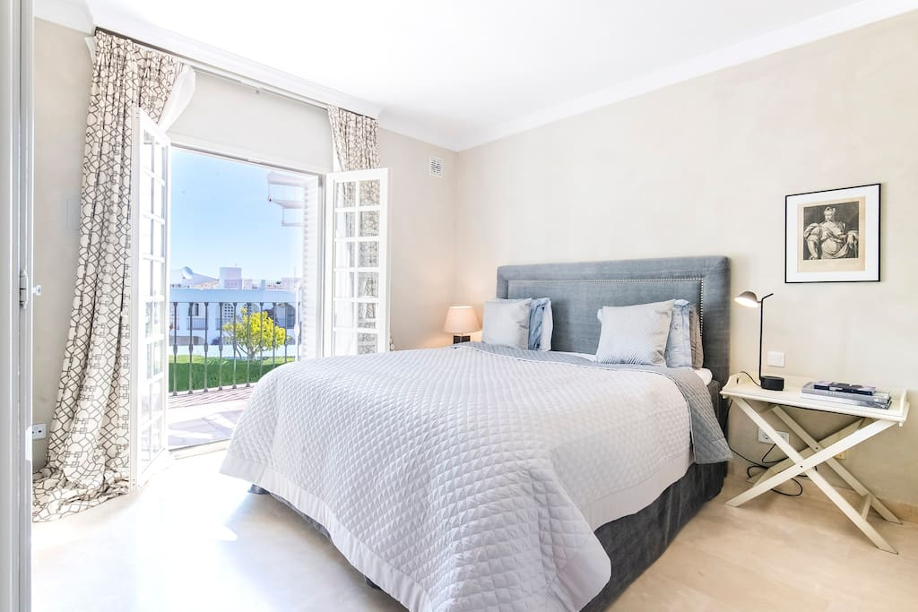 Nice master bedroom with plush beddings, ensuite bathroom and private terrace with sea and golf views