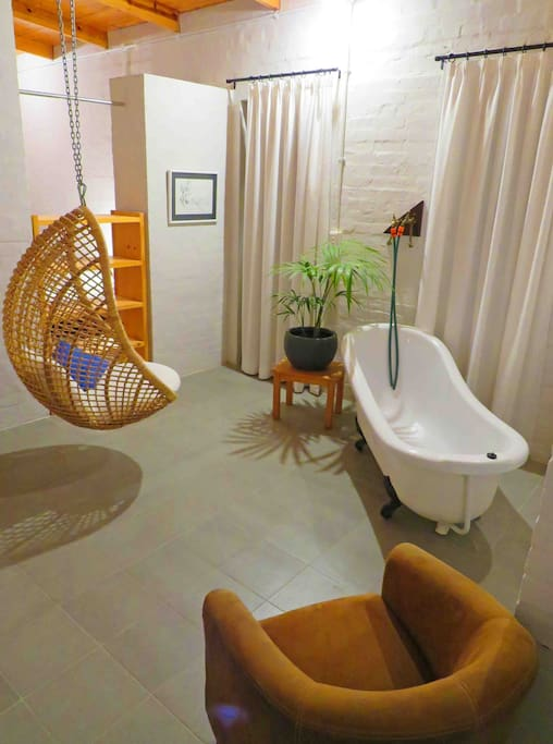 free standing bath in the open plan room