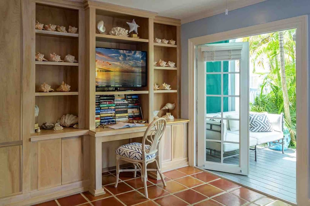 Living room has a home office and a TV. So it is your choice: work or leisure...