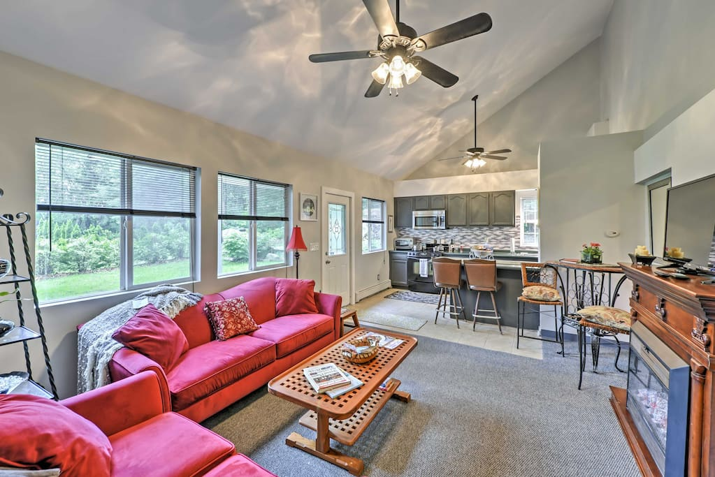 Vaulted ceilings and modern appliances greet you upon entering the home.