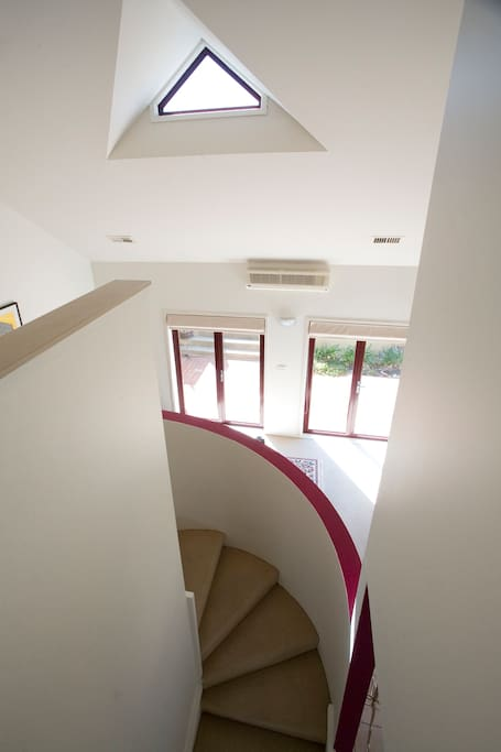 Take the stairs to the peace and quiet of your top floor room!