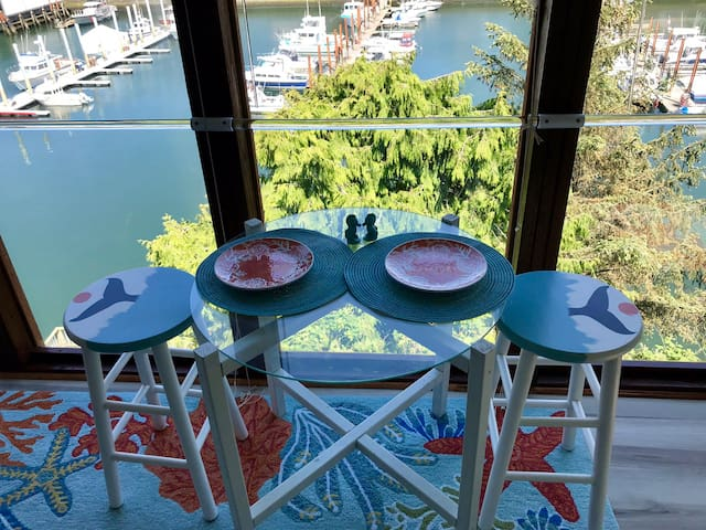 The dining table features stools hand-painted by Carrie herself!