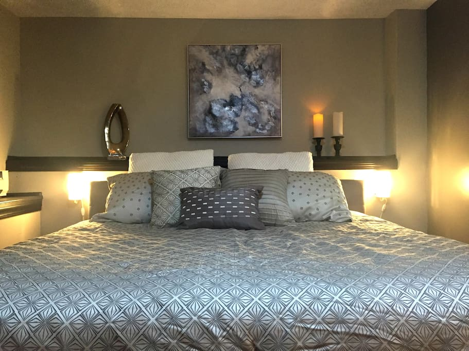 King bed with hotel mattress and premium bedding.