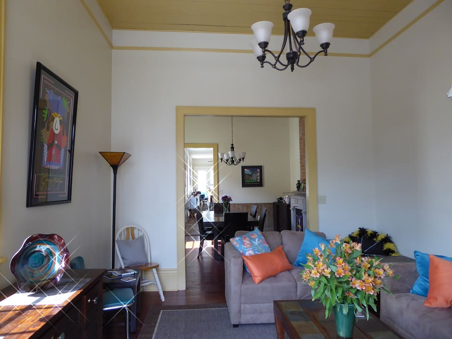 Living room looking through to the dining room and kitchen and back porch.
