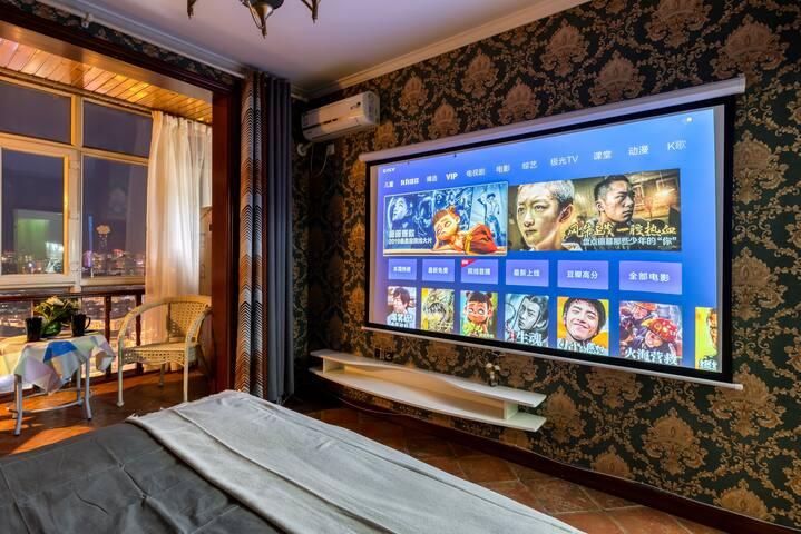 易佳公寓巨幕投影房,一室一厅,1.8米大床房,中央大街,冰雪大世界,卓展购物中心