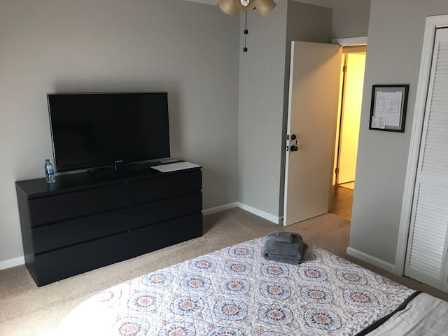 "Bedroom with 42"" TV connected with a Fire Stick."
