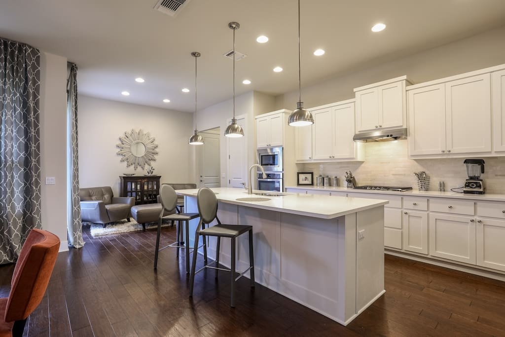 Gourmet, eat-in kitchen with adjacent sitting/lounge area.