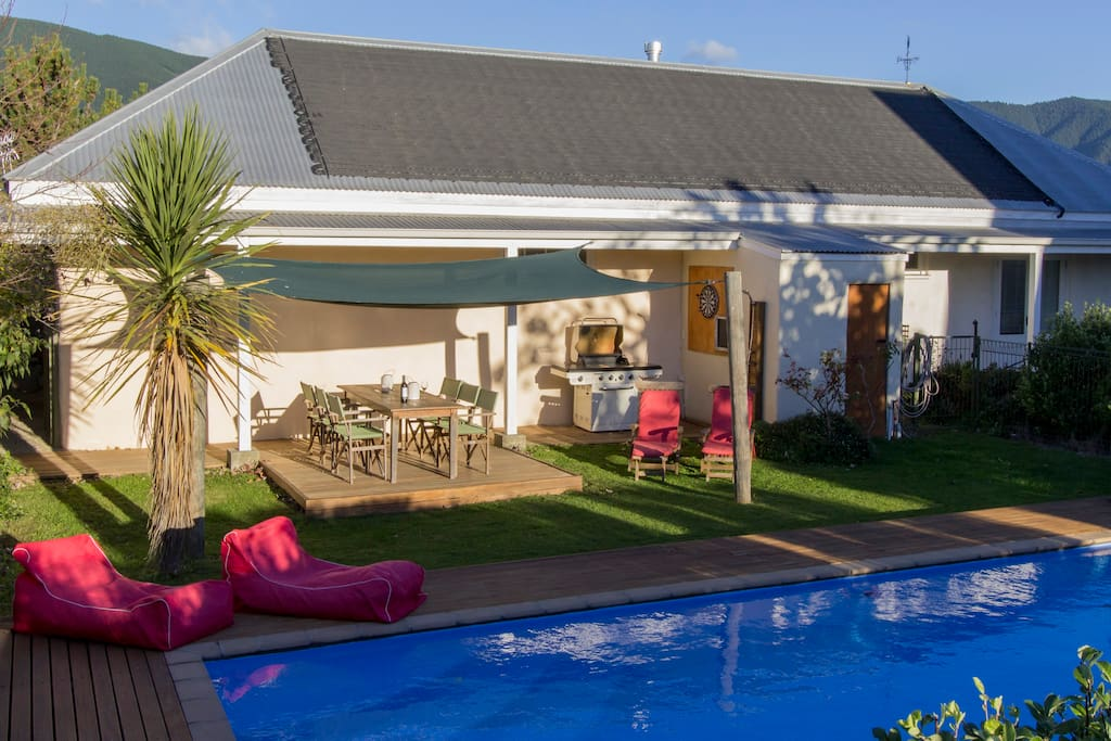Woodstock Suite your private garden with BBQ area, solar heated swimming pool