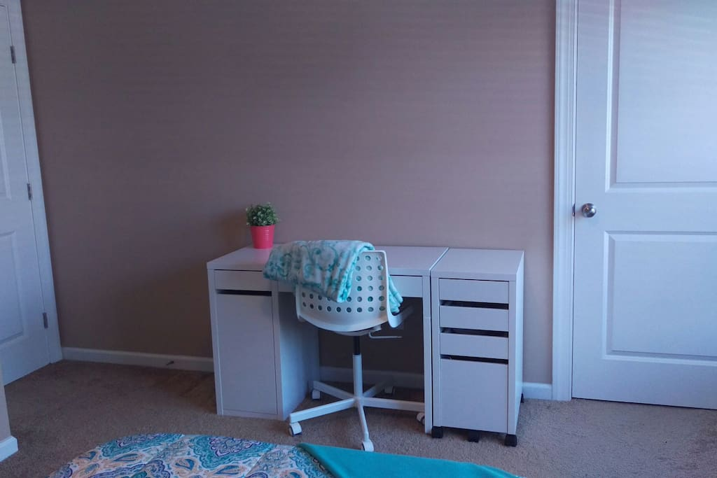Desk with ample workspace in bedroom 1