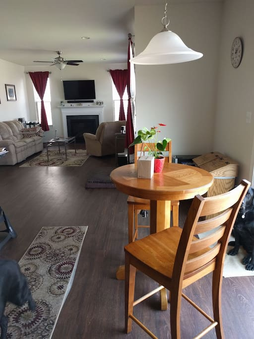 Breakfast area seating for 2. Living room with fireplace has seating for 4.