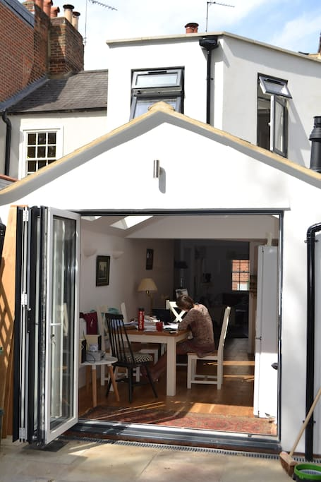 Large bi-fold doors bring the outside in