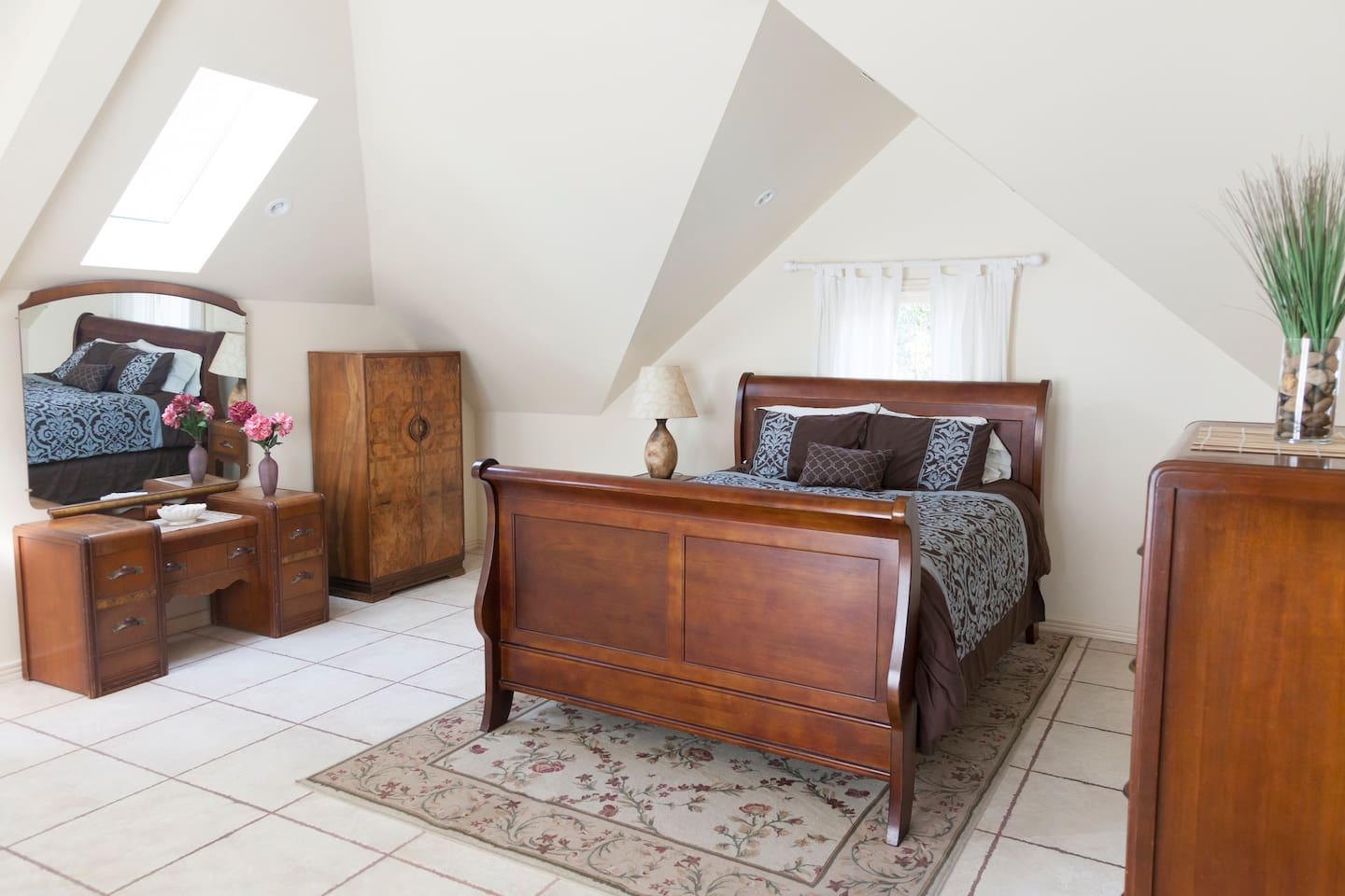 The room is spacious and features a queen bed, private bathroom, sitting area, private entrance, and balcony.