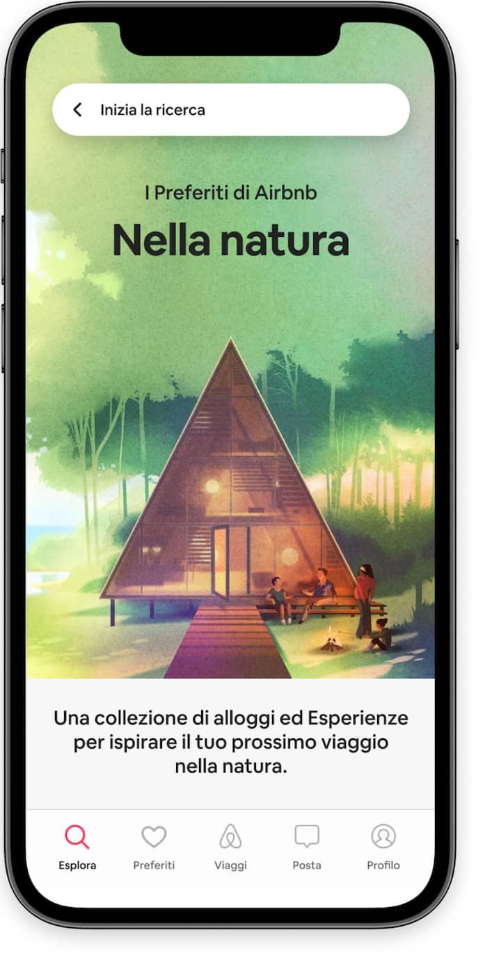 """Schermata iniziale che evidenzia la collezione di preferiti dal tema """"Nella natura"""" nell'app di Airbnb."""