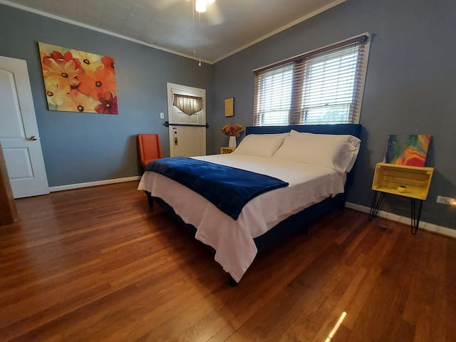 Front bedroom with a super comfortable hybrid King bed and plenty of room for a provided air mattress.  Ceiling fan.