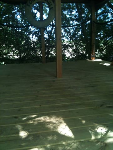 ~9x14 size of deck The space can accommodate 2 queen sized air beds or a small tent.