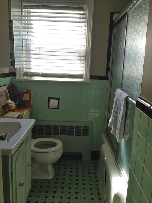 Shared bathroom with a tub and shower