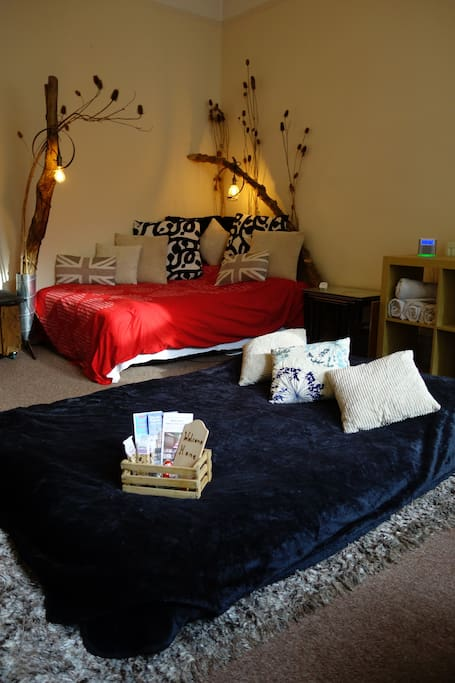 Two double beds with limitless pillows and blankets for 4 people. 2 additional single beds are available to comfortably set up on the adjacent floor space.