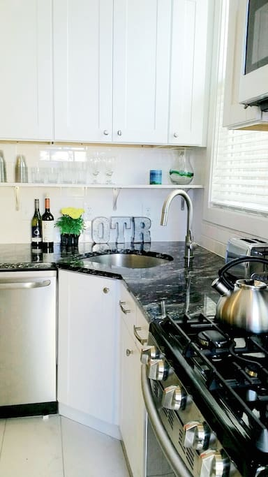 Kitchen with granite countertops and stainless steel appliances.