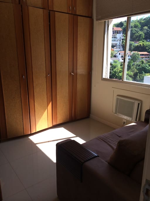 Bedroom with air conditioner and sofabed