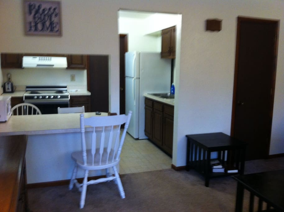Stocked kitchen with Full size Refrigerator/Electric Stove/Microwave/Coffee Pot