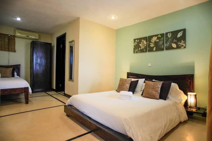 Tropical Minimalist Room in an Ocean View Oasis