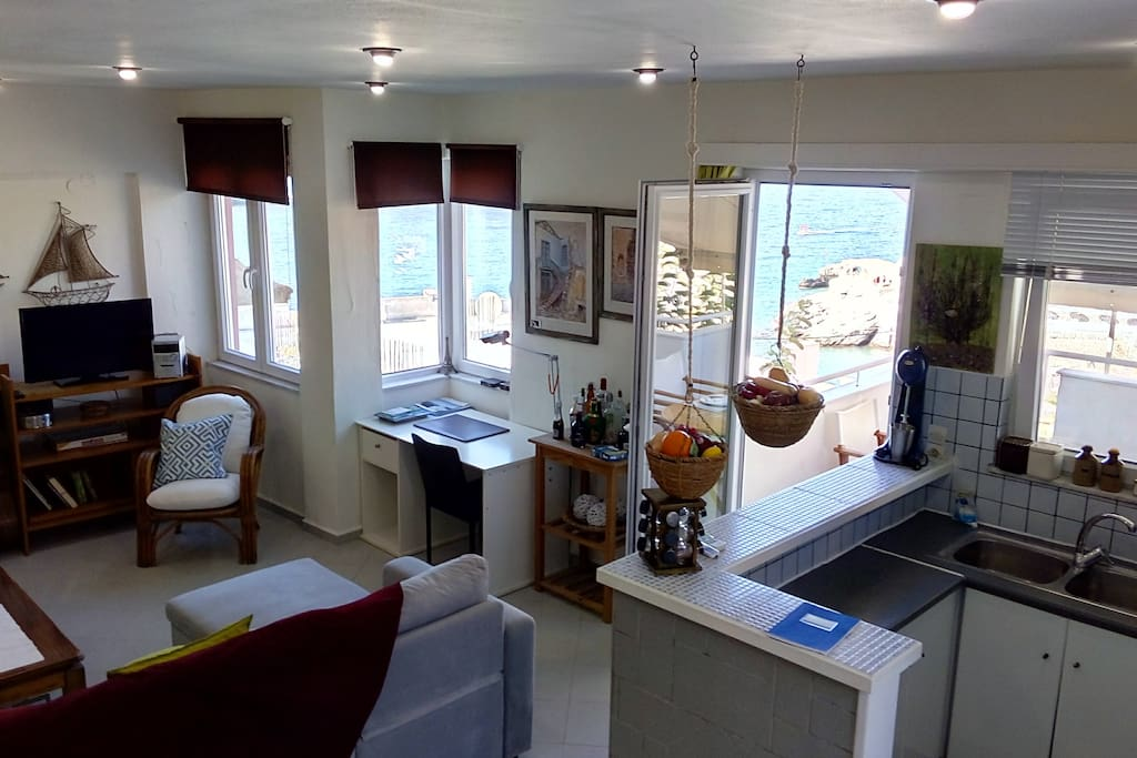 Living room, Dining room, kitchen with a view of the village and sea!κξ
