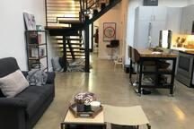 Living room and kitchen view facing toward front door-