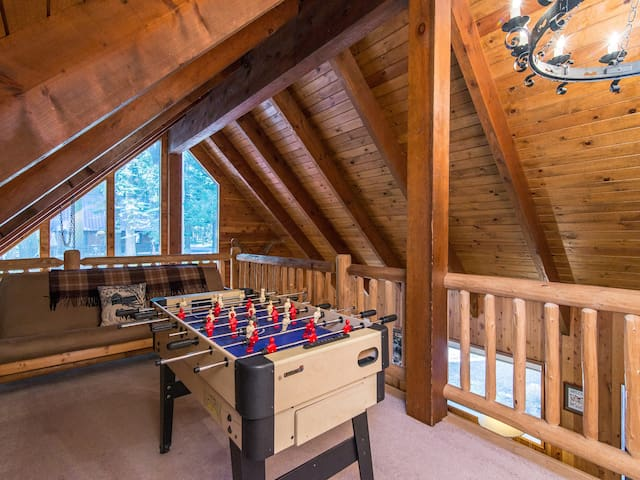 Challenge the group to a friendly foosball tournament in the loft, where a futon sleeps 2.