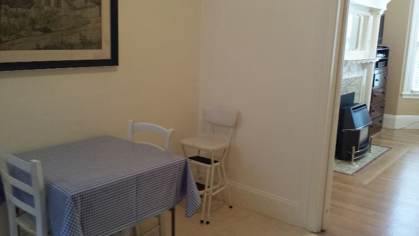 Enjoy a light snack or a big meal at this quaint table for two (or three).