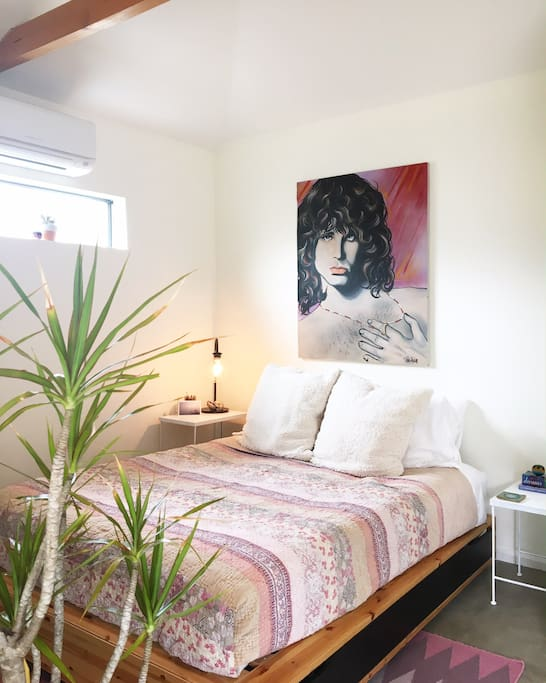 The bungalow is filled with some of our favorite books, treasures from around Venice, and this Jim Morrison painting that my husband's friends commissioned for him when he graduated college.