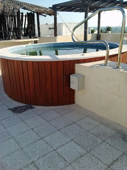 The 4th floor roof top has a whirlpool, hammocks , lawn chairs over looking the caribbean sea.