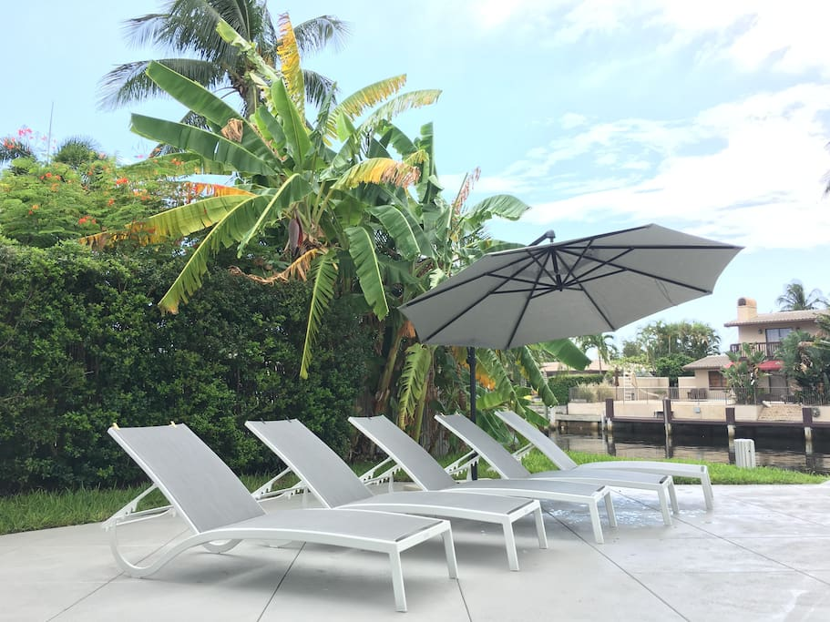 Chaise Lounges Poolside w/ Umbrella