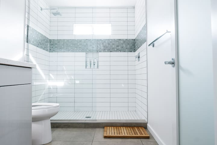 All new bathroom with high-end finishes. We provide all the basics; body wash, shampoo, conditioner, towels, body lotion, hair dryer, and cotton swabs.