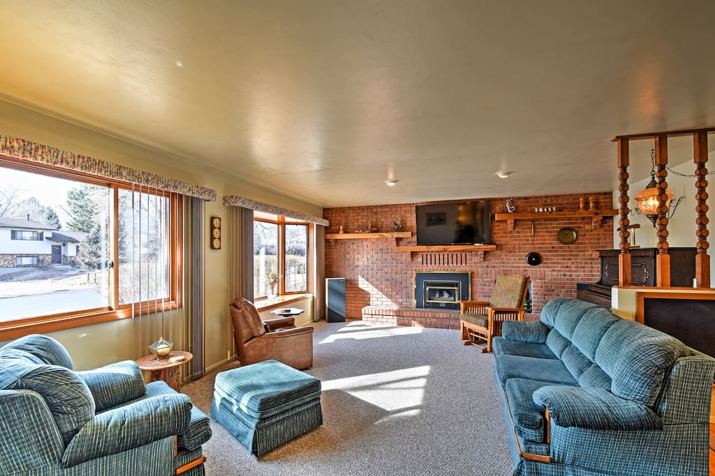 The spacious living area offers plush couches to relax in.