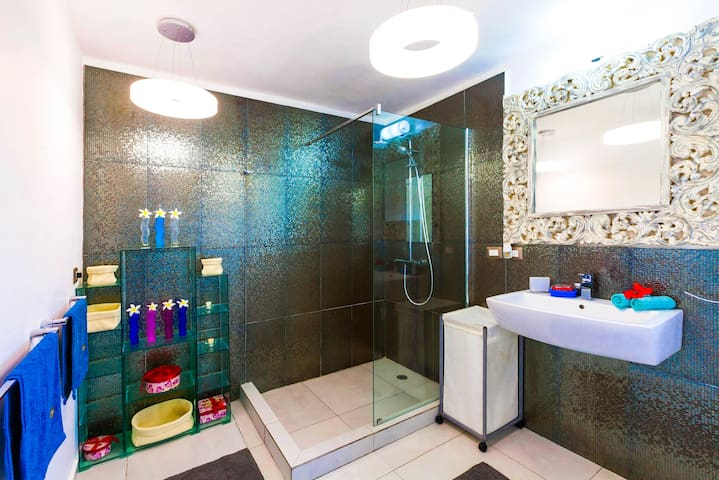 Modern shower for your comfort.It is next to your Master bedroom. It's very bright and fresh, free towels, shampoo, linen are included