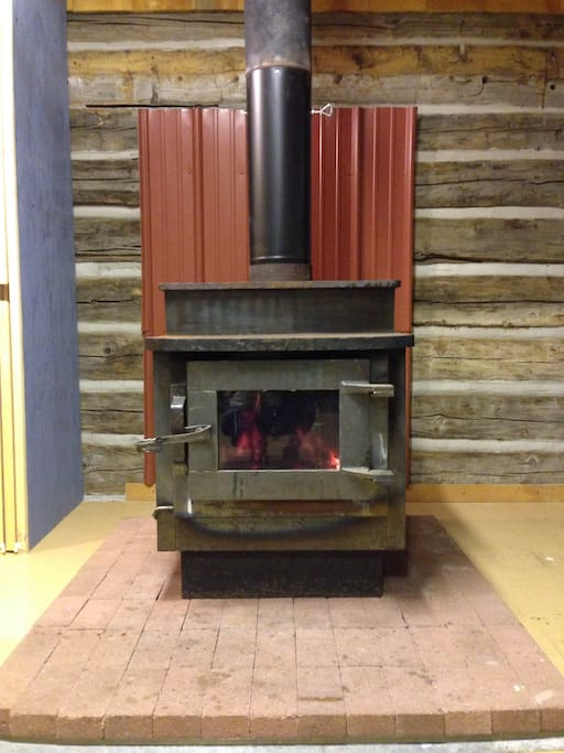 Locally crafted, well made wood burning fireplace. We provide all the wood you need to stay warm and cozy.