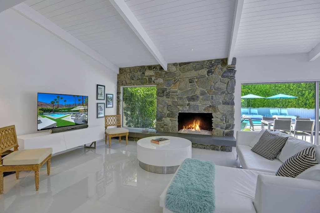 Another fireplace—this one indoors—and a wall-mounted flat screen TV.